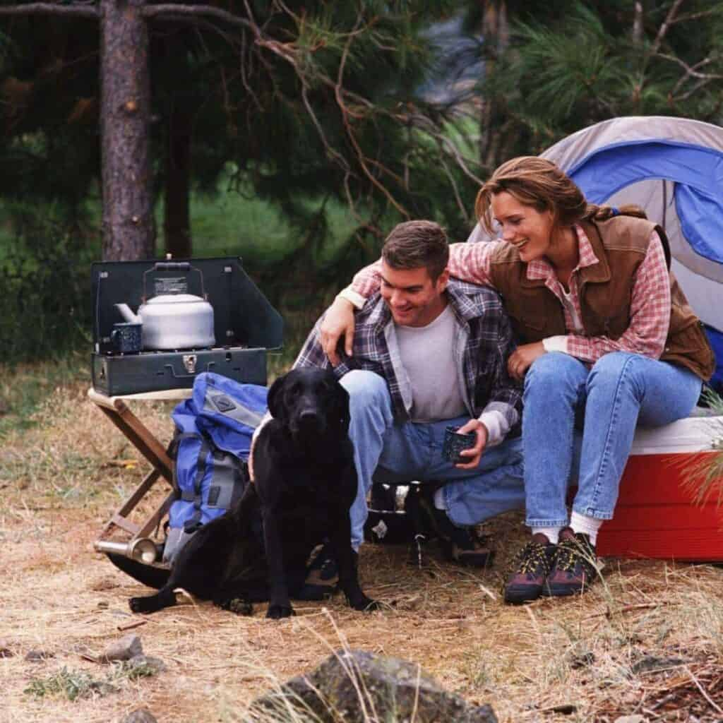 A family and dog camping